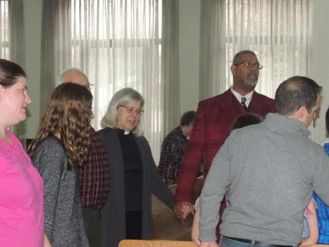 Photo by Drew Parker The Rev. Cynthia Byers of the Walter of Lawrencefield Parish Church and Deacon Martin of Macedonia Baptist Church attend a Martin Luther King Jr. reflection ceremony in Wheeling Sunday.