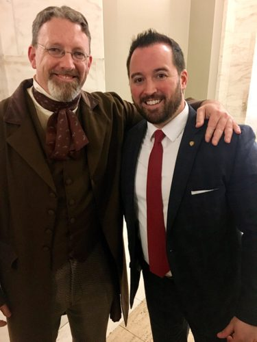 Photo by Janet Metzner Former Wheeling resident Travis Henline, left, dressed as West Virginia founding father Francis Pierpont, greets Delegate Shawn Fluharty, D-Ohio, Monday during inaugural festivities for Gov. Jim Justice.