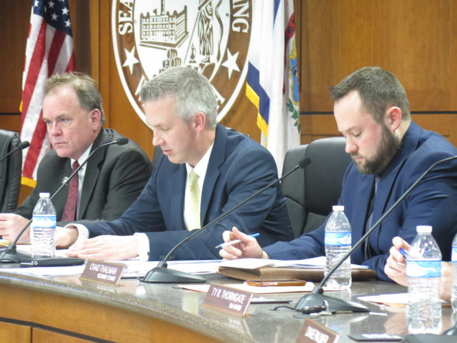 Photo by Alec Berry Wheeling City Manager Robert Herron, from left, Mayor Glenn Elliott and Vice Mayor Chad Thalman listen during Tuesday's council meeting.