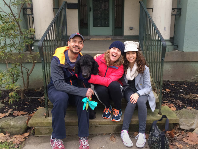 Photo Provided Rebecca Kiger, center, poses with her husband David Camilo, left, and daughter Olivia.