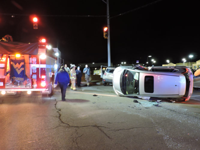 Photo by Janell Hunter A two-car accident at Wal-Mart Drive and W.Va. 2 caused one car to roll over on its side, and two people were transported to the hospital.
