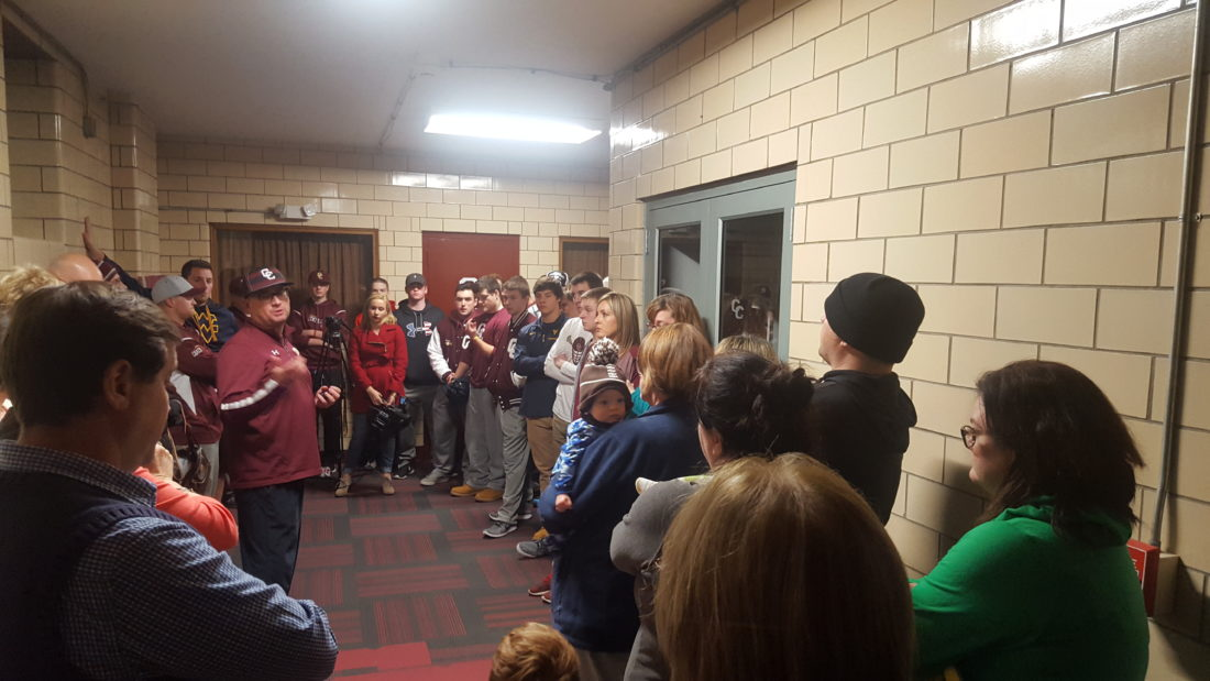 Students, players,  parents and assistant coaches rally at Wheeling Central Catholic High School Friday in support of head football coach Mike Young.  Photo by                 Shawn Rine