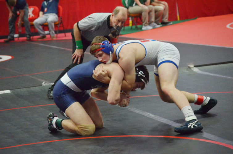 Wheeling Park's Kaleb Simpkins, top, gets Buckeye Local's Jason Binkiewicz in a difficult position during their match Friday at WesBanco Arena in the 64th Ron Mauck OVACWrestling Championship.