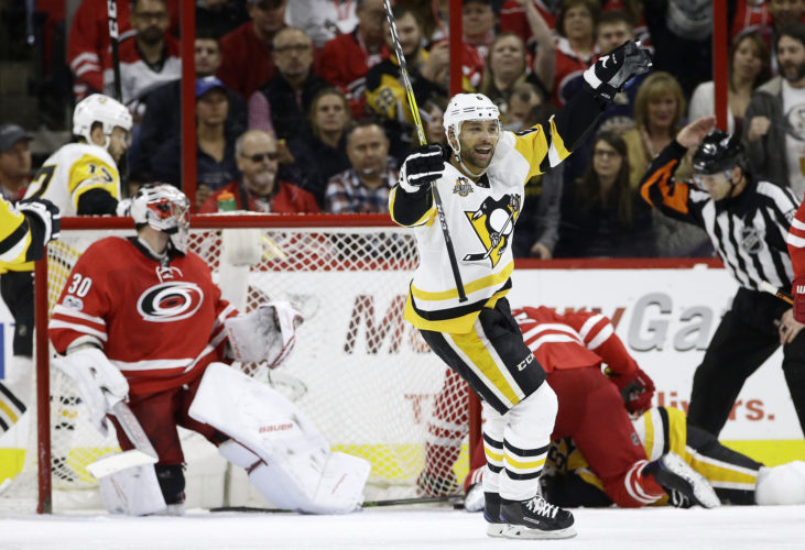 Pittsburgh Penguins' Trevor Daley celebrates a goal scored by Conor Sheary, not shown, against Carolina Hurricanes goalie Cam Ward (30) during the second period of an NHL hockey game in Raleigh, N.C., Friday, Jan. 20, 2017. Pittsburgh won 7-1. (AP Photo/Gerry Broome)