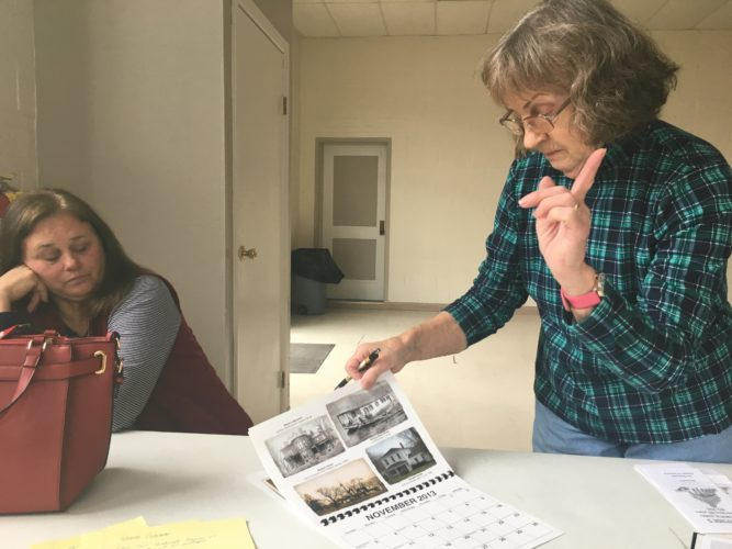 Photos by Craig Campbell Sisters Barb Fehr, left,  and Helen Bundorf display historic documents and pictures of Shadyside.