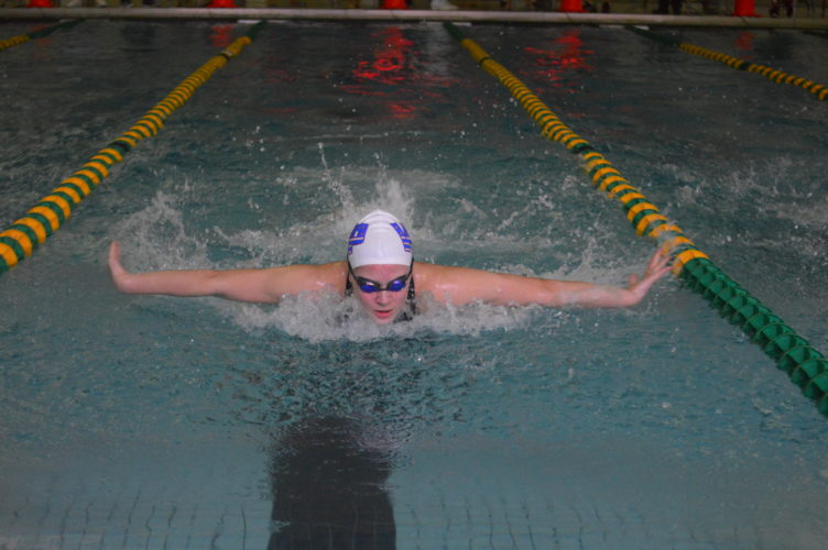 Photo by Cody Tomer Wheeling Park's Sarah Heilman competes in the OVAC 100 butterfly as she set a new school record for the event.
