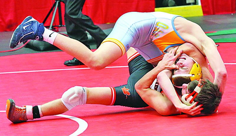 Photo by Alex Kozlowski Oak Glen's Peyton Hall, top, grapples with Shadyside's Greg Quinn during their championship match at 120.