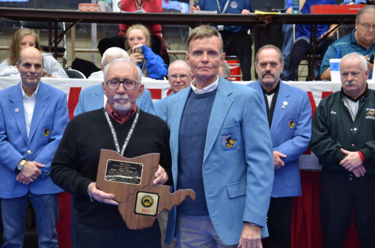 Photo by Kim North Chick LaMotte, left, was named the 41st Mr. Mat during the annual OVACWrestling Tournament. Presenting him the award is Steve Kish.