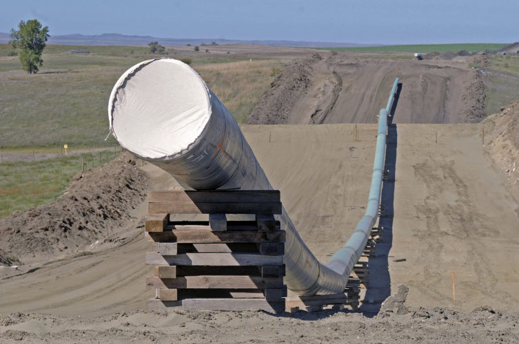 FILE - This Sept. 29, 2016 file photo, shows a section of the Dakota Access Pipeline under construction near the town of St. Anthony in Morton County, N.D. Texas-based Energy Transfer Partners, the company building the oil pipeline, asked a a federal judge on Tuesday, Jan. 17, 2017, to block the U.S. Army Corps of Engineers from launching a full environmental study of the $3.8 billion pipeline's disputed crossing of a Missouri River reservoir in North Dakota. (Tom Stromme/The Bismarck Tribune via AP, File)