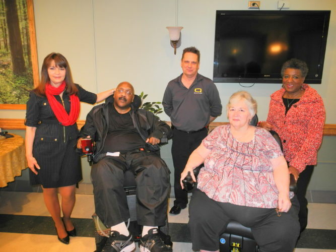 Photo by Heather Ziegler From left are Heart2Heart Volunteers Inc. director Sharon Travis; Peterson Rehabilitation Hospital patient Shawn Thomas; Pride Mobility Corp. representative Dave McGraw; patient Linda Cox; and Heart2Heart Assistant Director Marcia Allen.