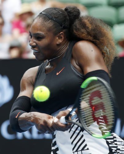 United States' Serena Williams makes a backhand return to Barbora Strycova of the Czech Republic during their fourth round match at the Australian Open tennis championships in Melbourne, Australia, Monday, Jan. 23, 2017. (AP Photo/Kin Cheung)