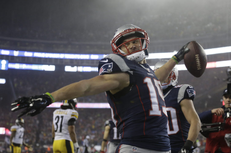 New England Patriots wide receiver Chris Hogan celebrates his touchdown catch during the first half of the AFC championship NFL football game against the Pittsburgh Steelers, Sunday, Jan. 22, 2017, in Foxborough, Mass. (AP Photo/Elise Amendola)