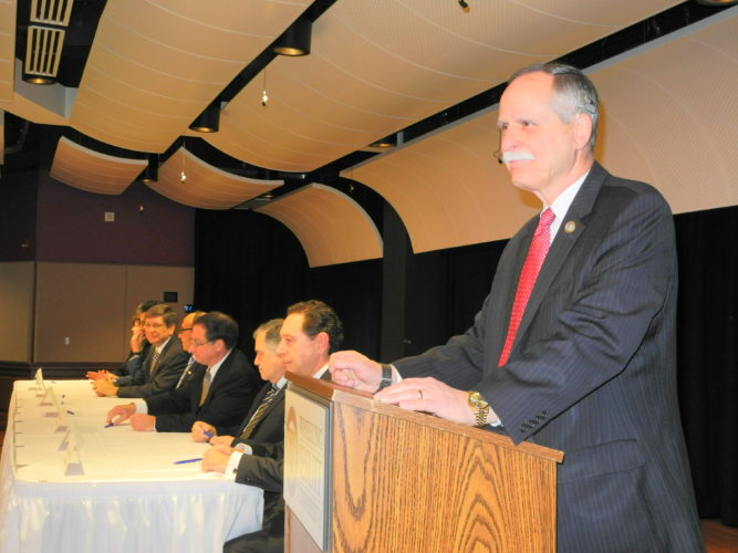 Photo By Heather Ziegler U.S. Rep. David McKinley, R-W.Va., prepares to address the Ohio Valley Research Consortium at Wheeling Jesuit University this morning.