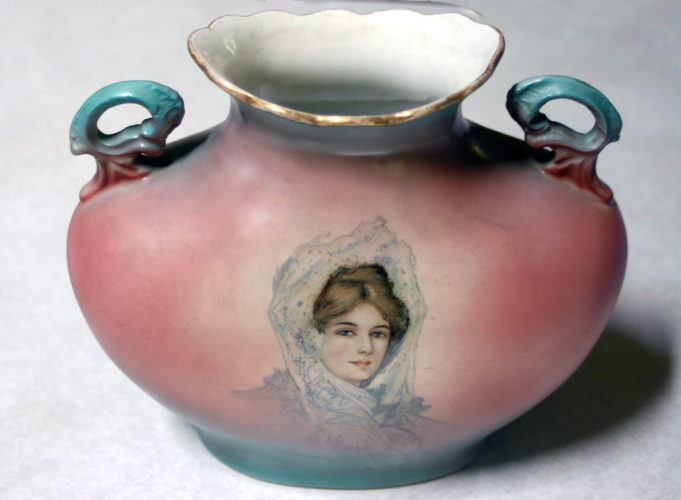 This pastel tinted portrait vase by Warwick is a recent find for a local collector. It is pink with tinges of aqua and edged in gold.