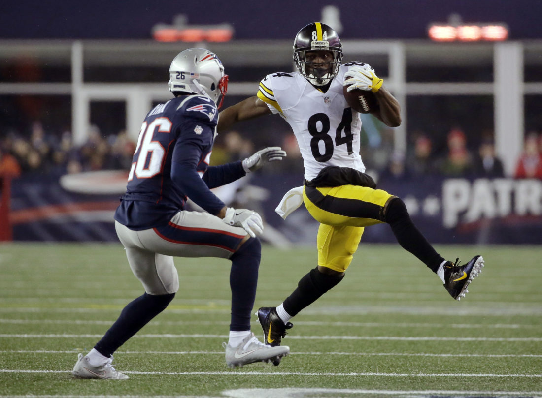 Pittsburgh Steelers wide receiver Antonio Brown (84) runs against New England Patriots cornerback Logan Ryan (26) during the first half of the AFC championship NFL football game, Sunday, Jan. 22, 2017, in Foxborough, Mass. (AP Photo/Steven Senne)