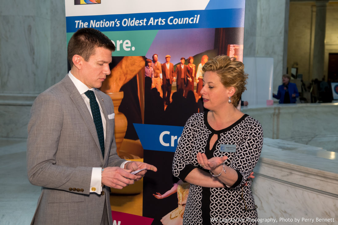 "Photo by Perry Bennett, W.Va. Legislature West Virginia Sen. Ryan Weld, R-Brooke, speaks with Oglebay Institute President Danielle McCracken during ""Arts Day"" at the state Capitol in Charleston on Wednesday."