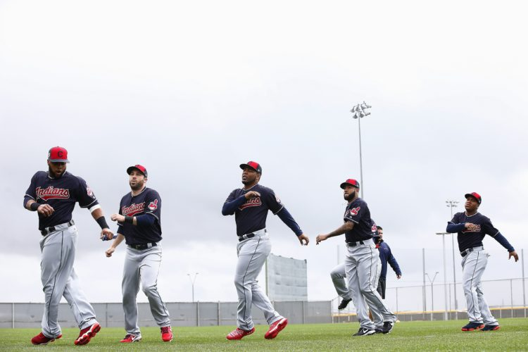 As clouds move in, Cleveland Indians position players run through their exercises at the Indians' baseball spring training facility Sunday, Feb. 19, 2017, in Goodyear, Ariz. (AP Photo/Ross D. Franklin)