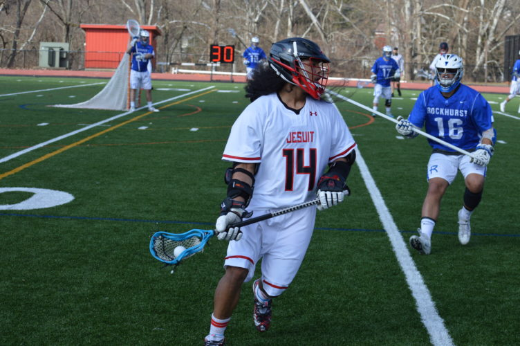 Photo by Cody Tomer Wheeling Jesuit's Matt Lee (14) looks to make a play in Sunday's lacrosse action.