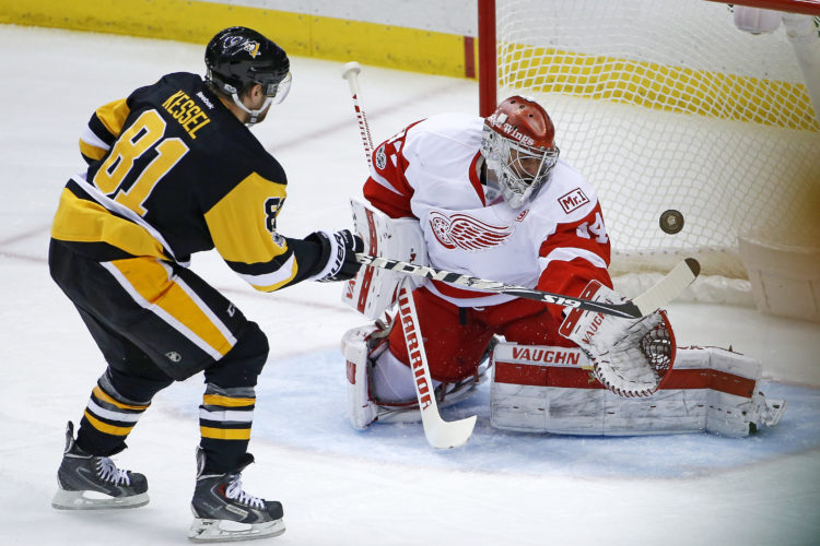 Pittsburgh Penguins' Phil Kessel (81) can't get a shot past Detroit Red Wings goalie Petr Mrazek (34) in the first period of an NHL hockey game in Pittsburgh, Sunday, Feb. 19, 2017. (AP Photo/Gene J. Puskar)
