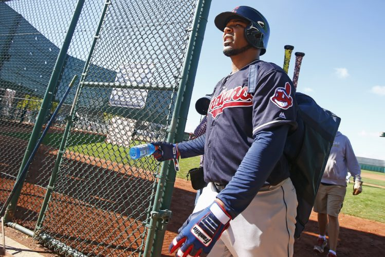 Cleveland Indians' Edwin Encarnacion heads to another field after batting at the team's baseball spring training facility Monday, Feb. 20, 2017, in Goodyear, Ariz. (AP Photo/Ross D. Franklin)