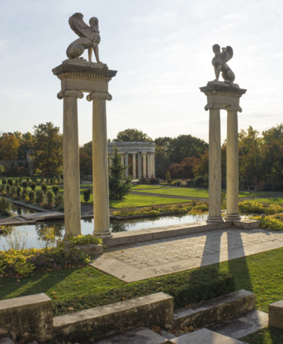 "This undated photo provided by The Monacelli Press shows Untermyer Park and Gardens in Yonkers, N.Y. Sphinxes by Paul Manship crown pairs of Cippolino marble columns. Across the lawn is the Temple of the Sky. The gardens are featured in the book ""Rescuing Eden: Preserving America's Historic Gardens."" (Curtice Taylor/The Monacelli Press via AP)"