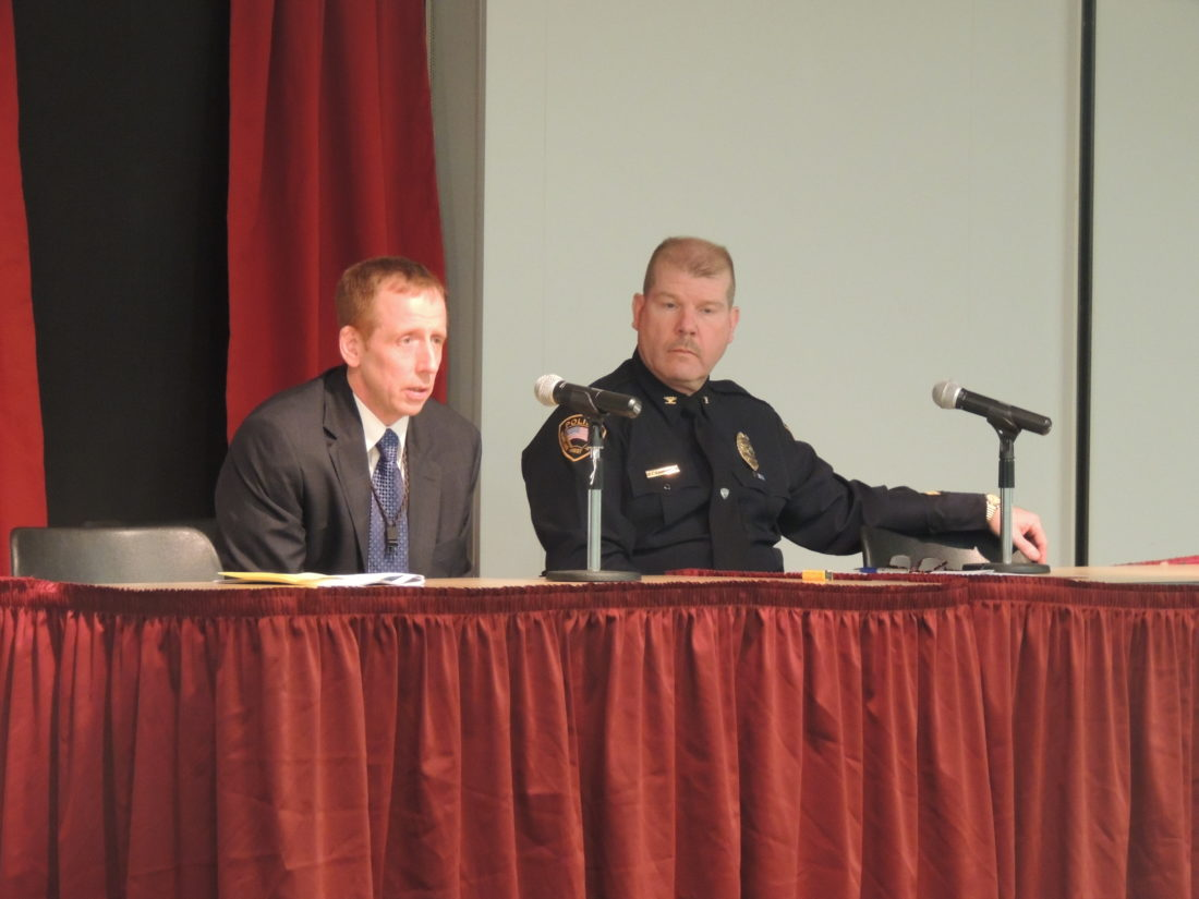 Photo by Drew Parker Wheeling Police Chief Shawn Schwertfeger, right, addresses a town hall meeting on race relations at West Virginia Northern Community College Wednesday with FBI Special Agent Gregg Frankhouser.
