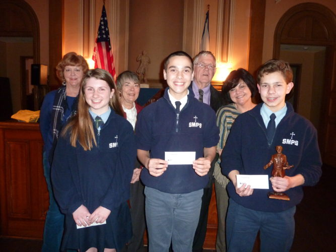 Photo by Linda Comins Winners of the West Virginia Independence Hall Foundation's writing contest are St. Michael Parish School students, from left, Margaret Hartzell, second place; Gino Gentile, third place, and Hunter Midcap, first place. Offering congratulations are foundation members, back row from left, Pattie Hershey, Lynne Exley, Dr. Joseph Laker and Dr. Leslie Liedel.