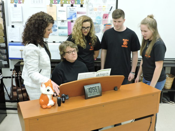 Photo by Alan Olson Musicians and educators practice their performance at Moundsville Middle School. From left are Kathy Fox, Christie Robison, Hannah Lynch, Isaac Woods and Amanda Rine.