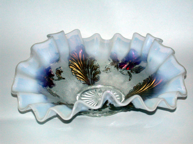 A sweet little crimped bowl is a lovely example of opalescent Goofus Glass and features gold trim.