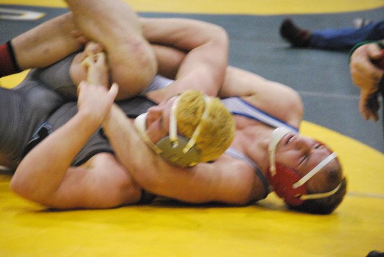 Photo by Kim North WheelingPark's Austin Loew wrestles against George Washington's Gerald Hall.