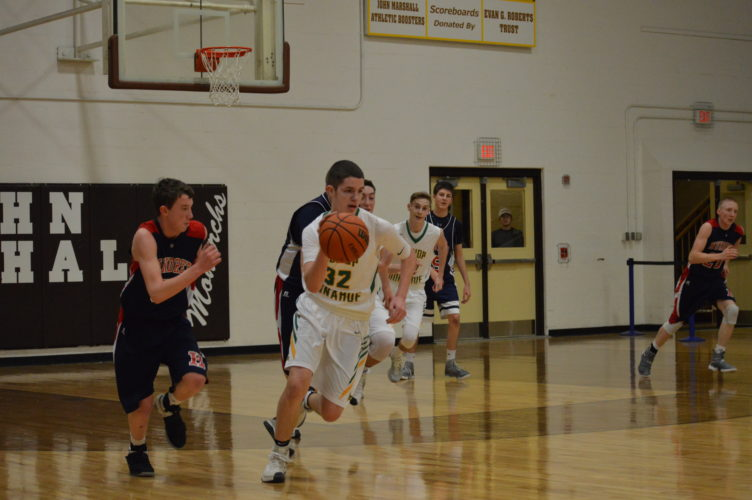Photo by Cody Tomer Bishop Donahue's Mickey Reilly (32) pushes the ball up the floor during a sectional quarterfinal victory against Hundred.