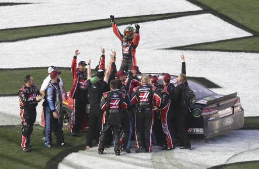 Kurt Busch, top, celebrates with crew members after winning the NASCAR Daytona 500 auto race at Daytona International Speedway in Daytona Beach, Fla., Sunday, Feb. 26, 2017. (AP Photo/David Graham)