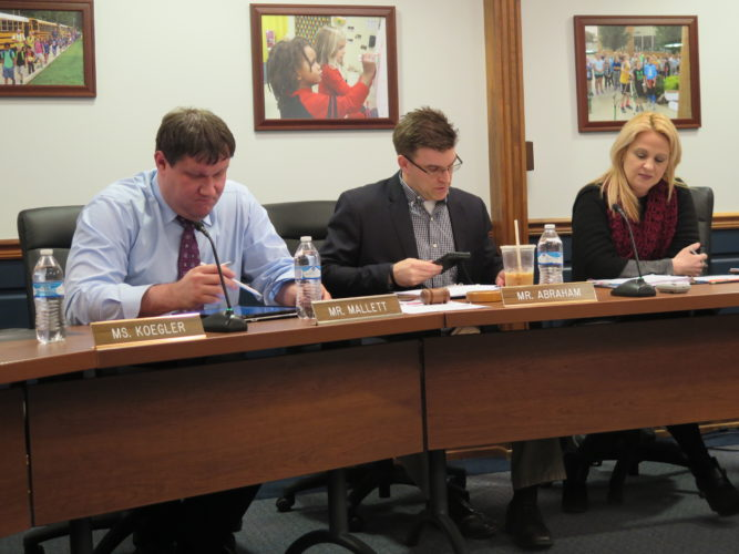 Photo by Joselyn King Ohio County Board of Education member Shane Mallett, left, board President Zach Abraham and Superintendent Kim Miller address issues during Monday night's board meeting.