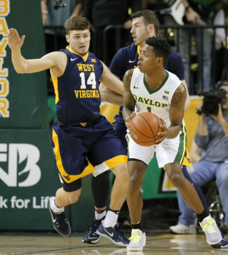 West Virginia guard Chase Harler (14) defends as Baylor's Wendell Mitchell (1) prepares to make a pass in the first half of an NCAA college basketball game, Monday, Feb. 27, 2017, in Waco, Texas. (AP Photo/Tony Gutierrez)
