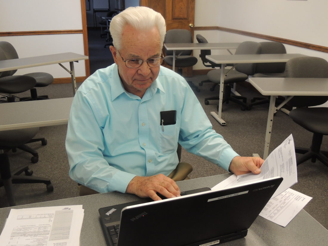 Photo by Drew Parker Lloyd Earnest, energy management specialist for Marshall County Schools, assesses the school district's energy use during 2016.