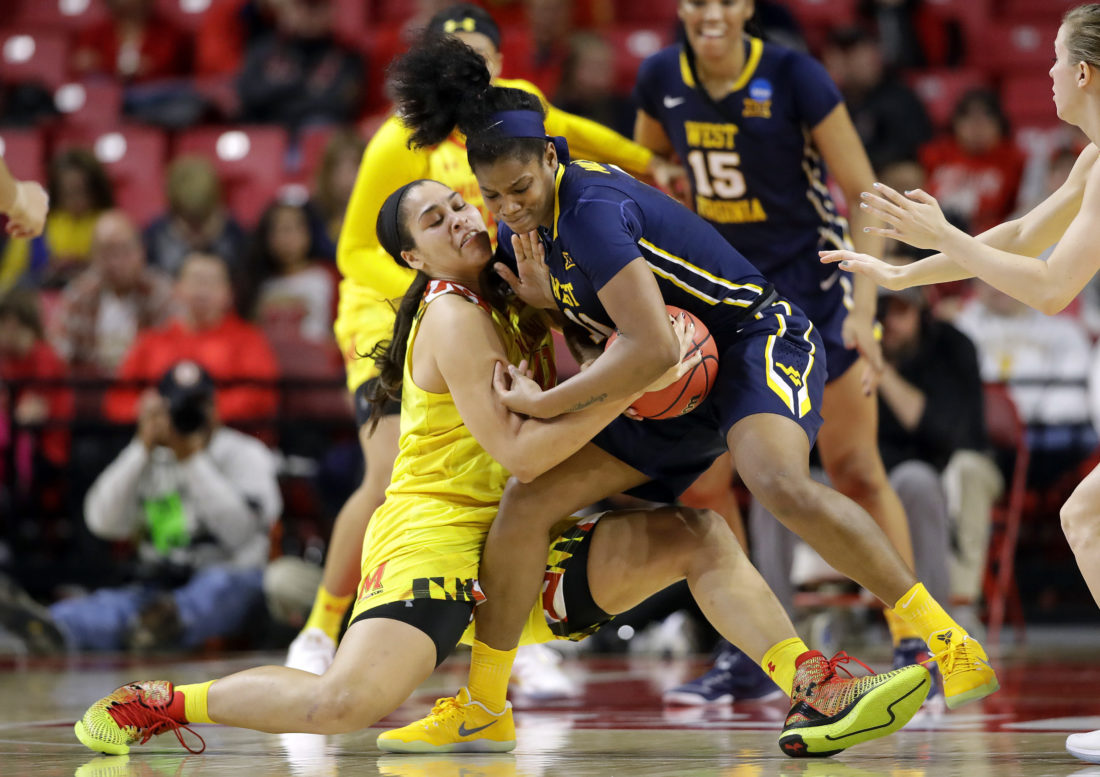 Maryland center Brionna Jones, left, tries to strip the ball away from West Virginia forward Teana Muldrow in the second half of a second-round game in the women's NCAA college basketball tournament in College Park, Md., Sunday, March 19, 2017. (AP Photo/Patrick Semansky)