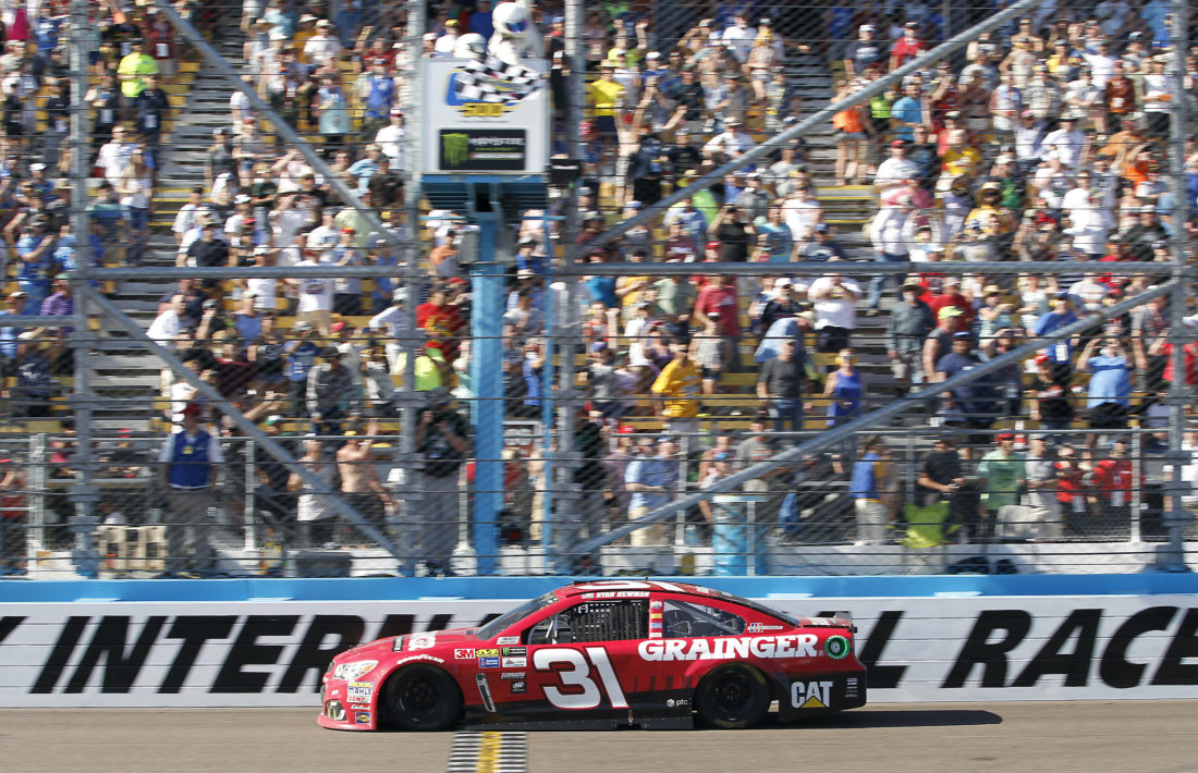 Ryan Newman takes the checkered flag to win the NASCAR Cup Series auto race at Phoenix International Raceway, Sunday, March. 19, 2017, in Avondale, Ariz. (AP Photo/Ralph Freso)
