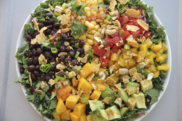 This March 9, 2017 photo shows a black bean and mango salad in Coronado, Calif. This dish is from a recipe by Melissa d'Arabian. (Melissa d'Arabian via AP)