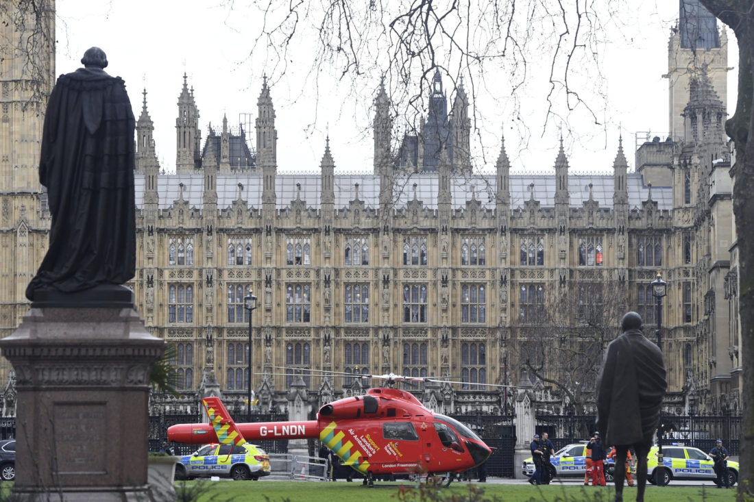 An Air Ambulance on the scene after sounds similar to gunfire have been heard close to the Houses of Parliament, London, Wednesday, March 22, 2017. The UK House of Commons sitting has been suspended as witnesses report sounds like gunfire outside. (Victoria Jones/PA via AP)