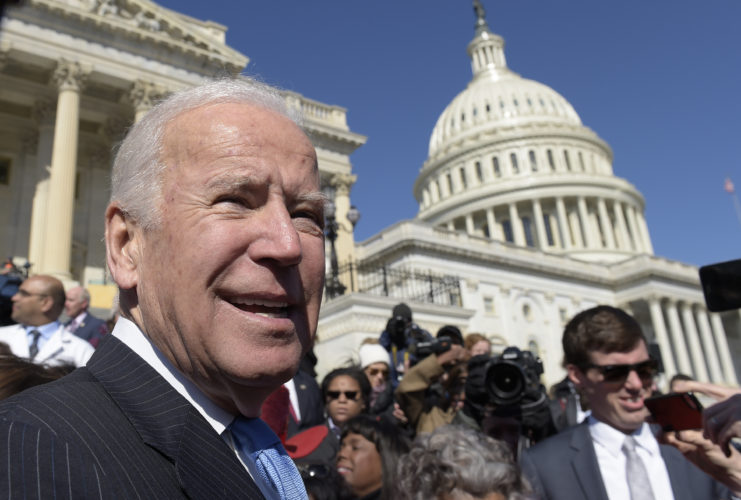 Former Vice President Joe Biden pauses as he greets the crowd on Capitol Hill in Washington, Wednesday, March 22, 2017, following an event marking seven years since former President Barack Obama signed the Affordable Care Act into law. (AP Photo/Susan Walsh)