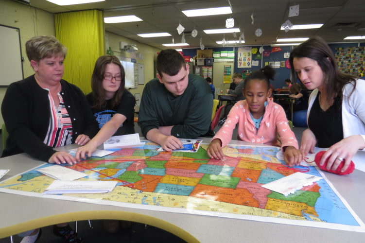 Photo Provided Pictured are Wheeling Middle School teachers and students charting schools across the country they have been in contact with as part of the Great Mail Race. From left are teacher Renee Marchese, students Samantha Fleming, Jeremy Wright and Dae'Sha Gordon, and teacher Jenny Craig.