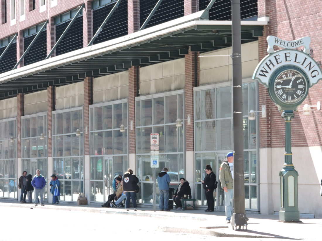 Photo by Casey Junkins Residents await an Ohio Valley Regional Transportation Authority bus at the Robert C. Byrd Intermodal Transportation Center on Main Street in downtown Wheeling.