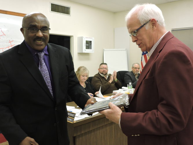 Photo by Alan Olson Marshall County Chamber of Commerce Executive Director Dave Knuth, right, receives recognition from Moundsville Mayor Eugene Saunders during a recent city council meeting.