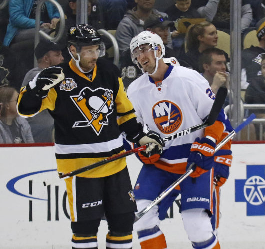 New York Islanders' Brock Nelson (29) skates behind Pittsburgh Penguins' Mark Streit (32) on his way to the bench after scoring in the second period of an NHL hockey game in Pittsburgh, Friday, March 24, 2017. (AP Photo/Gene J. Puskar)