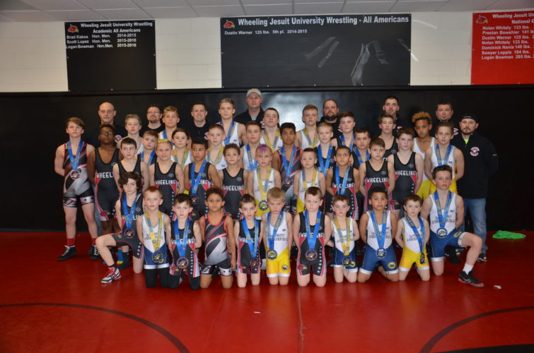 Photo by Kim North / The Wheeling Small Fry Wrestling Club had quite a season this year, culminating with nine state champions, nine state runnersup and a team championship at the W.Va. Youth Wrestling Association state tournament in Huntington recently. Pictured are, front row from left, Jake Jenkins, Tanner Burkhart, Cash Wilbert, Beau Braunlich, Evan Cottrill, Bradyen Frye, Gavin Young, Trey Brawner and Nic. Lowe. Second row, from left, are Jed Hanley, Noah White, Terrance Brawner, George Mamokas, Issac Sands, Brock Humphrey, Tylick Marshall, Cody Taggart and Carter Lucas. Third row, from left, are Braxton Bitter, Quinton Velas, Jamison Maynard, Brady Cottrill, Kolan Wiley, Seth Franke, Wyatt Brady, Preston Fitzpatrick and Braden Lucas. Fourth row, from left, are Rylie Watkins, Nate Shelek, Charlie Tombaren, Hunter Nixon, Billy Gooch, Erick Brothers, Jason Ross, Ethan Nally and Issac (Mike) Martin. Back row, from left are coaches Todd Shelek, Jeremy Lowe, Josh Braunlich, Eric Cottrill, Erick Brothers, Kevin Junkins, Jeremy Velas and Brian Humphrey.