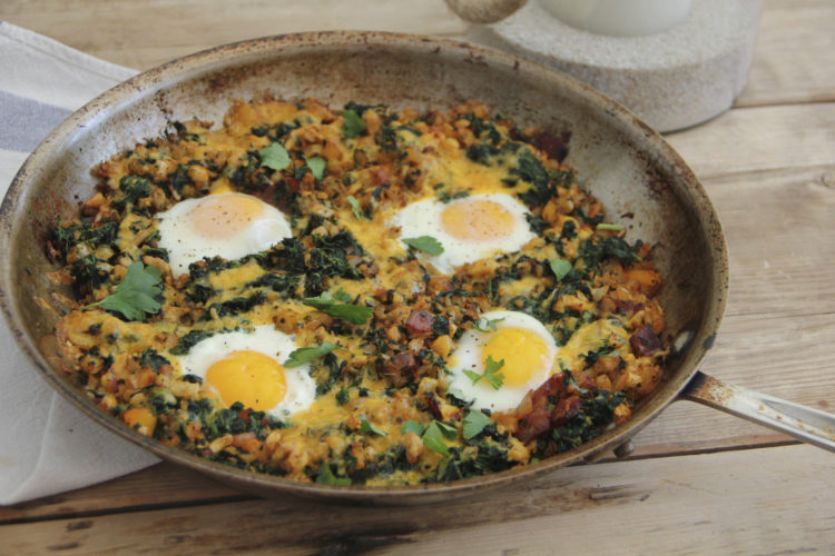 This March 6, 2017, photo shows a country-style breakfast skillet with eggs, bacon and vegetables in Coronado, Calif. This dish is from a recipe by Melissa d'Arabian. (Melissa d'Arabian via AP)