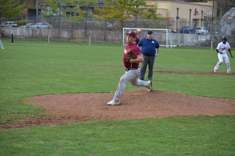 Photo by Cody Tomer WheelingCentral's Adam Murray pitches during the Maroon Knights game against LinslyMonday.