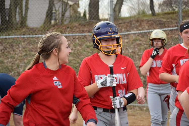 Photo by Rick Thorp St. Clairsville's Taylor Gallentine, left, congratulates teammate Hannah Stachyra on her three-run homer