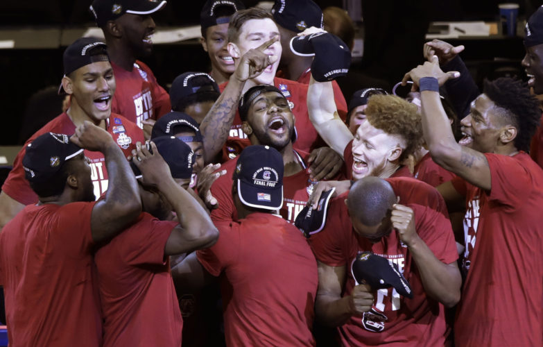 South Carolina players celebrate after beating Florida 77-70 in the East Regional championship game of the NCAA men's college basketball tournament, Sunday, March 26, 2017, in New York. (AP Photo/Frank Franklin II)