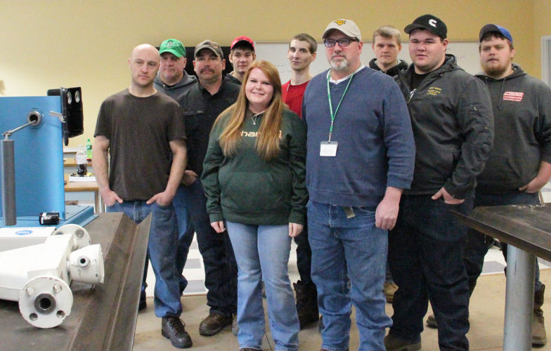 Photo Provided Students in the petroleum technology program at West Virginia Northern Community College meet with Denny Russell of Pegasus Optimization Managers LLC, which provided lab equipment valuable to the learning process. From left are Randy Donahue, Erik Wojtowicz, Russell, Ricky Yoho, Sarah Morse, Corey Carroll, Keith Carroll, Robert Walker, Kody White and Gage Francis.